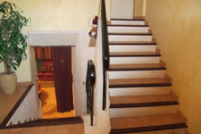 Stairs leading to upper 3 bedrooms and terrace.